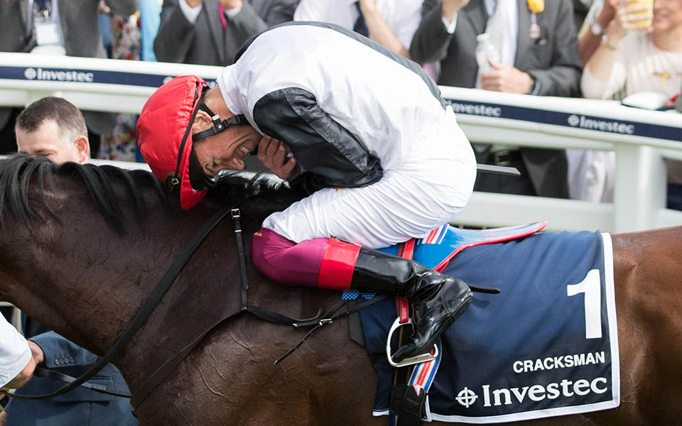 Jockey Frankie Dettori celebrates winning the Investec Coronation Cup on Cracksman during ladies day of the 2018 Investec Derby Festival at Epsom Downs Racecourse